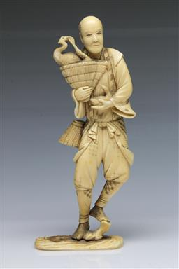 Sale 9093 - Lot 31 - Meiji Ivory Okimono of a Fisherman with Bird (with losses and repairs, H21.5cm)