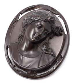 Sale 9145 - Lot 374 - A VICTORIAN CAMEO BROOCH; oval vulcanite cameo featuring a portrait of a lady (restoration to nose), size 52 x 43mm, on brass pin, w...