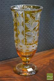 Sale 8255 - Lot 1032 - Large Bohemian Amber Overlay Cut Glass Vase, with rose design & on circular foot