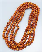 Sale 9037F - Lot 17 - A TWO METER LONG AMBER BEAD NECKLACE; composed of 10mm freeform beads.