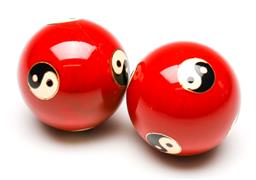 Sale 9238 - Lot 53 - A boxed pair of red ground Chinese tonal stress balls featuring yin/yang symbols (Dia:4.5cm)
