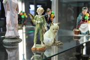 Sale 8296 - Lot 5 - Royal Worcester Figure of a Boy with Bird & A Cat Figure
