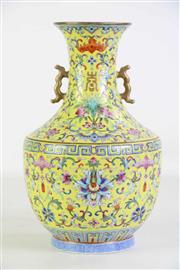 Sale 8913C - Lot 82 - Famille Yellow Chinese Twin Handled Vase (H27cm)