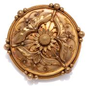 Sale 9020 - Lot 374 - AN ANTIQUE GOLD BROOCH; 43.9mm round dome brooch with applied trefoil, sunflower, bead and scroll wire work decoration to rope twist...
