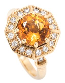 Sale 9160 - Lot 373 - AN 18CT GOLD CITRINE AND DIAMOND RING; centing a round cut citrine of approx. 1.75ct to octagonal surround set with 16 round brillia...