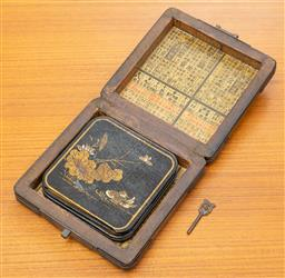 Sale 9164H - Lot 88 - A Japanese gilt box containing coasters, 14cm x 14cm, together with a reclining marble deity, damaged
