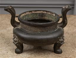 Sale 9160H - Lot 160 - An antique Chinese bronze censer with twin handles and raised on tri-feet with dragon motif, Width 36cm