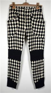 Sale 8460F - Lot 85 - A pair of monochrome Tsumori Chisato wool paints in floral chequered print with black bands to ankle and knees, size 3 Japan