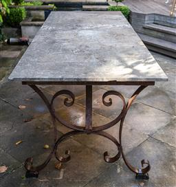 Sale 9160H - Lot 2 - A weathered marble rectangular topped outdoor table on an iron base with curled end supports, Height 75cm x Width 210cm x Depth 81cm...