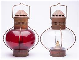 Sale 9185E - Lot 4 - A pair of Sherwoods Ltd Birmingham copper and brass kerosene ship lanterns, one with ruby red glass, Height without handle 38cm