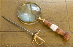 Sale 9248H - Lot 75 - A magnifying glass and a letter opener, length 25cm