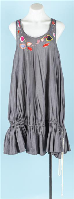 Sale 9091F - Lot 82 - A GORMAN COTTON SLEEVLESS SUNDRESS; grey with applique and hand embroidery accents to the top, draw string drop waist, size XS