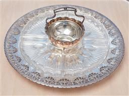 Sale 9099 - Lot 167 - A Continental silver-plated circular nut dish together with a silver plated pierced dish with glass inserts. Diameter 37cm