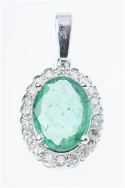 Sale 8293 - Lot 377 - AN 18CT WHITE GOLD DIAMOND AND EMERALD CLUSTER PENDANT; centring an oval emerald estimated as 1.60ct surrounded by 22 round brillian...