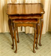 Sale 8392H - Lot 83 - A nest of three walnut tables with shaped top and slender cabriole legs