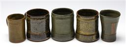Sale 9253 - Lot 85 - A collection of five studio pottery mugs (H:12cm to 10.5cm) - minor chips