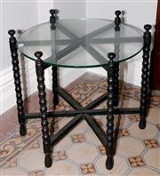 Sale 8048A - Lot 88 - A Circular glass top occasional table with bobbin turned gate leg action. 60 (h) x 60 (diam)