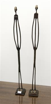 Sale 8205 - Lot 12 - Artist Unknown - A pair of Giacometti style figures male and female, H 59cm