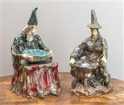 Sale 8650A - Lot 17 - A pair of wizard & witch pottery figures, marked with a pierced heart to base, Boyd?, larger Height 28cm.