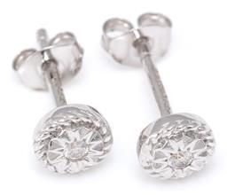 Sale 9156J - Lot 378 - A PAIR 18CT WHITE GOLD DIAMOND STUD EARRINGS; each illusion set with a 0.025ct round brilliant cut diamond, width 5.7mm, wt. 1.79g.