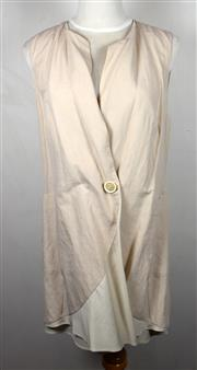 Sale 8460F - Lot 79 - A Brunello Cucinelli beige linen, silk lined long waistcoat with pockets and single press button, size 44