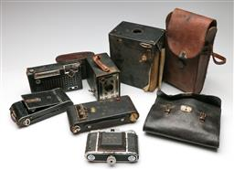Sale 9190 - Lot 84 - A collection of vintage cameras inc Brownie together with a radio and Agfacolour slides