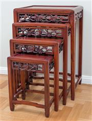 Sale 8562A - Lot 57 - A Chinese rosewood nest of four tables, each with carved and reticulated frieze, H 65cm
