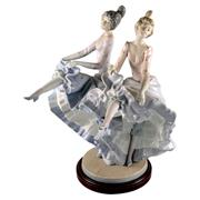 Sale 8000 - Lot 235 - A Lladro figural group of two dancers performing the can-can, printed and incised marks to base.