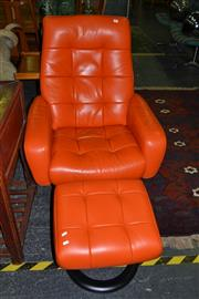 Sale 8013 - Lot 1409 - Burnt Orange Leather Recliner with Ottoman