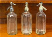 Sale 8261A - Lot 69 - A collection of three vintage soda siphons, including Tooth & Co, and Schweppes