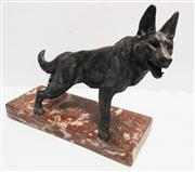Sale 8272A - Lot 48 - A French Art Deco bronzed metal dog figure on rouge marble base. Size 32  x 24 cm