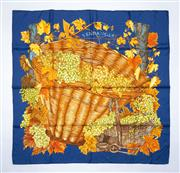 Sale 8760F - Lot 146 - An Hermes Vendanges silk scarf in blue with golden-green grapes