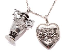 Sale 9182 - Lot 336 - A SILVER VICTORIAN STYLE HEART LOCKET AND PERFUME BOTTLE ON CHAIN; heart shape locket featuring greyhounds, size 38 x 26mm, and urn...