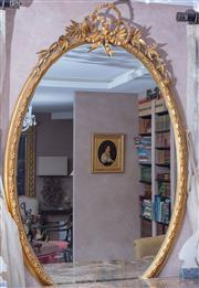 Sale 8568A - Lot 64 - A Louis XVI style gilt oval mirror, surmounted by a ribbon and laurel, approx. H 160cm