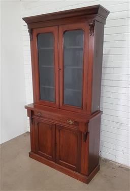 Sale 9162 - Lot 1003 - Victorian mahogany bookcase, with two arched glass panel doors, long drawer and two timber panel doors below (h:206 x w:108 x d:32cm)