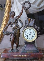 Sale 8568A - Lot 65 - An early C20th French spelter and rouge marble mantle clock with a lady holding a rose wreath Fleur Dete, after Ferville Suan, H 45...