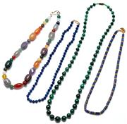 Sale 9054 - Lot 332 - FOUR GEMSTONE BEAD NECKLACES; 2 set with lapis, a 5.7mm round beads and an Etruscan style with 4.7mm round cylindrical beads and gra...