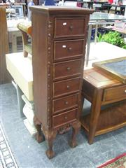 Sale 7933A - Lot 1161 - Tall Carved 6 Drawer Cabinet