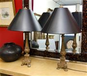 Sale 8205 - Lot 16 - A pair of classical style gilt timber decorative lamps with black shades on tripod bases, H 80cm