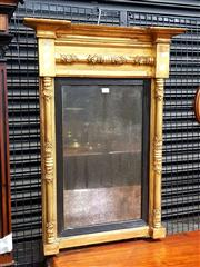 Sale 8693 - Lot 1037 - Regency Gilt Wall Mirror; framed by turned Column supports with applied shelves and ebonised slip.
