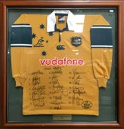 Sale 8863S - Lot 18 - Wallabies Signed Jersey for the 2001 Lions and Tri Nations Series, in frame