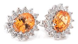 Sale 9132 - Lot 549 - A PAIR OF 18CT WHITE GOLD GARNET AND DIAMOND CLUSTER EARRINGS; each centring an oval cut orange spessartite garnet to surround of 14...
