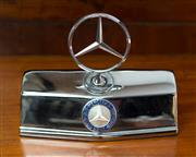 Sale 8261A - Lot 100 - A silvered mounted Mercedes Benz insignia, W20cm