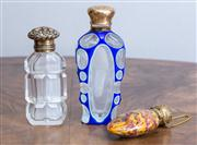 Sale 8650A - Lot 29 - A Victorian gilt and cut glass perfume bottle, together with a small enamelled perfume flask and a blue overlaid cut example with fa...
