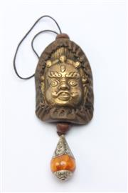 Sale 8677 - Lot 88 - Chinese Bronze Buddha Bust With Amber Like Pendant H: 12cm