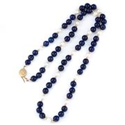 Sale 8866 - Lot 312 - A LAPIS AND PEARL BEAD NECKLACE; composed of 8.3mm round lapis beads spaced by 7mm round cultured pearls and small gold rondels to a...
