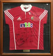 Sale 8863S - Lot 26 - 2001 British and Irish Lions Tour Signed Jersey, in frame