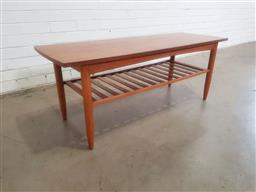 Sale 9151 - Lot 1151 - Timber coffee table with magazine shelf below (h:47 w:121 d:44cm)