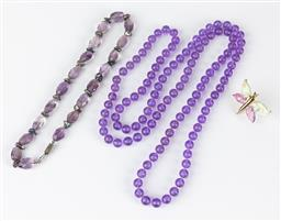 Sale 9250F - Lot 13 - A purple glass bead necklace, Length 30cm, together with a longer purple beaded example, and a glass butterfly scarf ring.