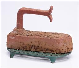 Sale 9185E - Lot 142 - A vintage cast iron iron, Length 25cm, together with a green painted trivet